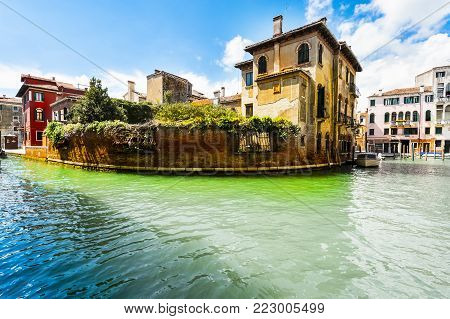 Houses peeling off from dampness. Venice is situated across a group of islands that are separated by canals and linked by bridges. Gondola is a traditional, flat-bottomed Venetian rowing boat