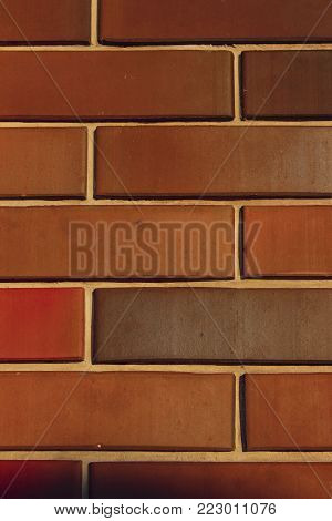 Cropped Shot of a Facebrick Wall. The Wall. Vertical Old Brick Wall Background.Wall Texture Grunge Background With A Lot Of Copy Space. Colorful Wall Texture. Background Texture.