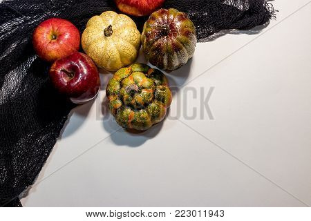 Apples and goards against a black cloth