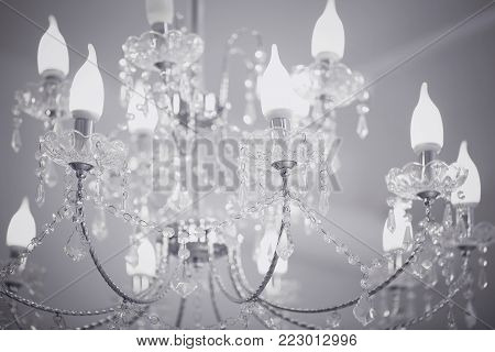Crystal chandelier close up on grey background