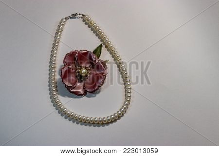 flower broach in pearls on white background