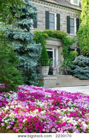 Landscaped House With Flowers