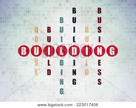 Constructing concept: Painted red word Building in solving Crossword Puzzle on Digital Data Paper background