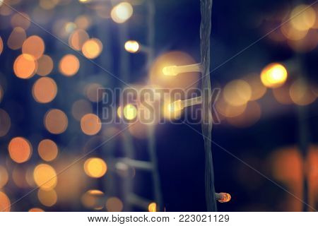 yellow string lights with bokeh decor in outdoor restaurant