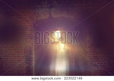 ghost little girl appears in underground tunnel,  halloween concept.