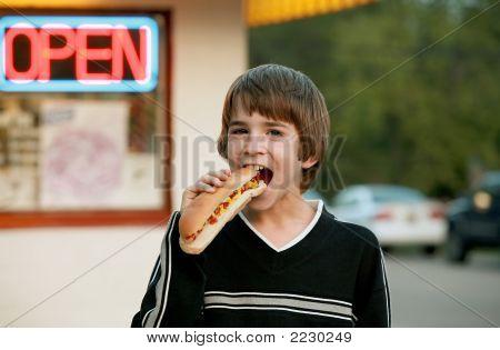 Boy Eating A Footlong Hot Dog