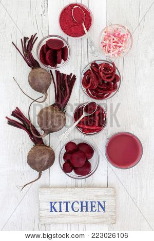 Beetroot vegetable health and super food with smoothie drink, fresh, powder, sliced, juice, pickled and shredded beetroot on rustic wood.. Contains anthocyanins, vitamins and antioxidants.