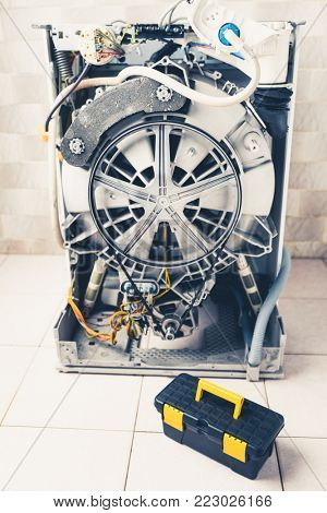 washing machine with open enclosure is ready for service