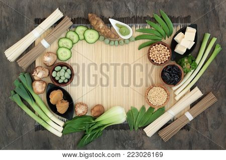 Macrobiotic diet food with wasabi paste and nuts, udon and sobu noodles, tofu, miso, legumes, wakame seaweed, grains and vegetables, foods high in protein, fibre,  antioxidants and vitamins.