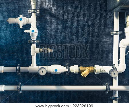 white plastic pipes in boiler room