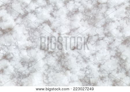 Sea salt mining, produced from the evaporation of seawater, close up background.