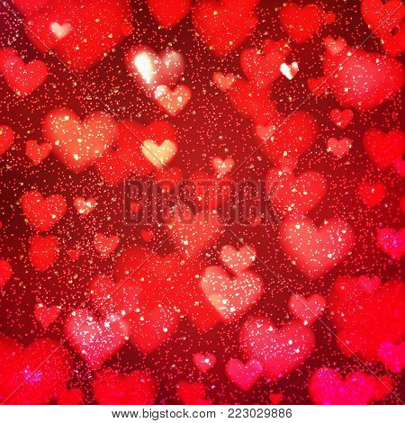 Abstract romantic red background with hearts and bokeh lights. St. Valentine's day wallpaper. Blurred glow soft backdrop. Vector illustration.