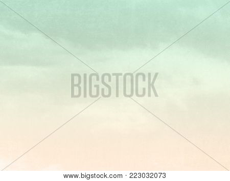 Retro sky background in faded pale watercolor texture