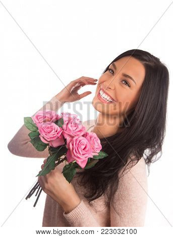 Beautiful happy female holding roses bouquet, Valentine or Women's day portrait. Isolated on white background.