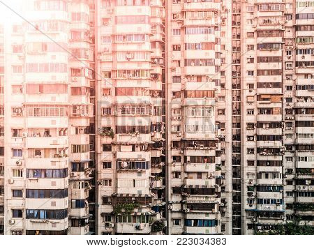 Windows and balconies of many residential apartments in chinese city, China.