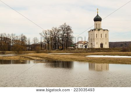 Russian ancient shrine. Orthodox Church of the Intercession on the Nerl River. Spring landscape. Vladimir region.