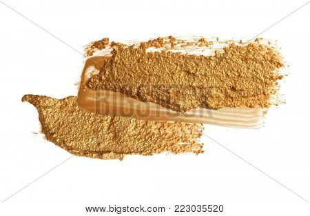 Abstract acrylic gold brush stroke. Isolated on white.