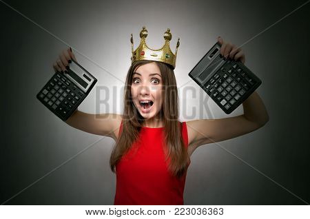 Big total sale. Discount final price. Lucky winner girl. Accountant woman in red dress and gold crown on her head shows a tax calculator.