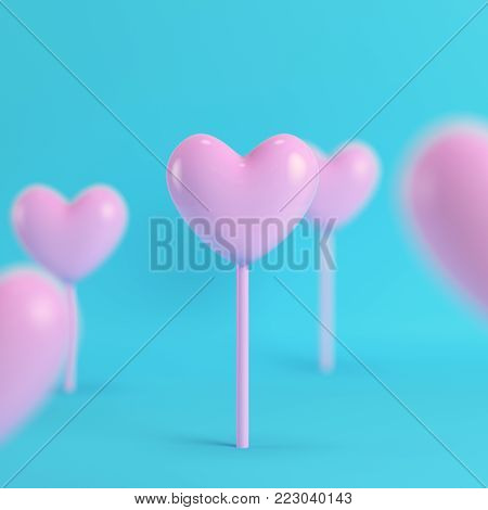 Pink hearts on a stick on bright blue background in pastel colors. Minimalism concept. 3d render