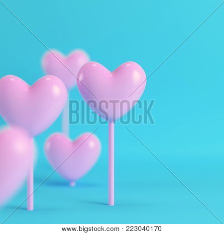 Pink hearts on a stick on bright blue background in pastel colors with copy space. Minimalism concept. 3d render