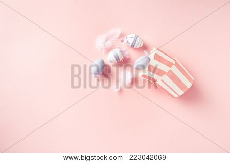 Easter Eggs and muffin tins on pastel pink background