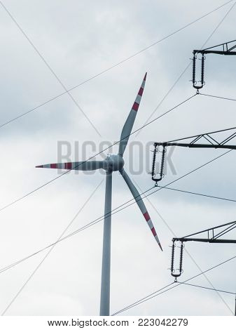 windmill and electricity pylons