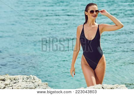 summer sunny fashion portrait of pretty young sensual redhair woman posing in bikini