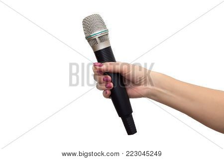 wireless microphone in a female hand on a white background isolated
