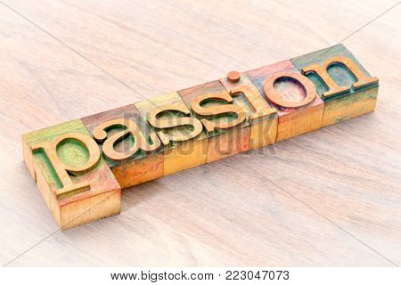 passion word abstract - a banner in vintage letterpress wood type blocks stained by color inks