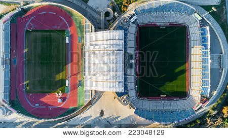 Nicosia, Cyprus - 25/12/2017: Aerial bird's eye view of GSP football stadium at Latsia.The soccer field, athlete track, seats and auxiliary pitch of Pancyprian Gymnastic Association Stadium from above