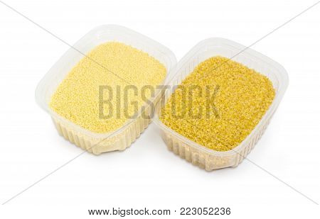 Uncooked couscous and bulgur in two small semi transparent plastic containers on a white background