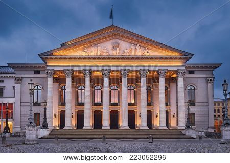 The National Theatre Munich at dusk. Max-Joseph-Platz Square in Munich, Germany