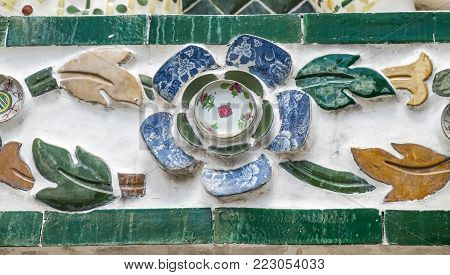 Close up view of the wall decoration of Wat Arun (Temple of Dawn) in Bangkok, Thailand