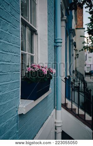 LONDON, UK - MAY 17, 2016: Colourful terraced houses of Notting Hill. Notting Hill is one of the most expensive residential areas in London, UK, famous for the yearly carnival.