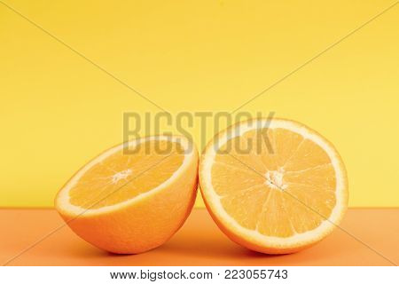 Fresh orange slice isolated on orange background.