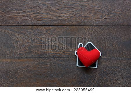 Table top view aerial image of love home background concept.Flat lay object on modern rustic brown wooden at home office desk.Space for creative design add text and graphic.Happy Valentine's day.