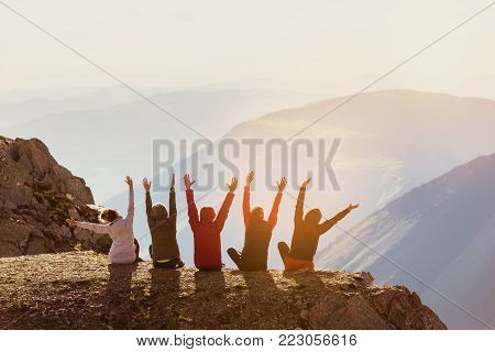 Group of five happy friends having fun at mountain top