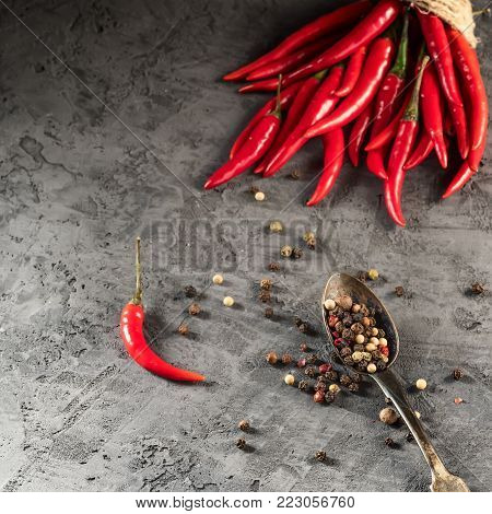 Red hot chilli pepper paprika in and peppers seed ball on stone table Ingredient for Mexican cooking Trendy toned image in minimal rustic style Flat lay top view