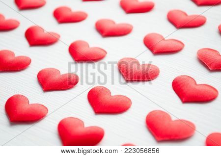 Romantic background. Red hearts on the white wooden background, shallow DOF, Romantic still life, St Valentines day concept