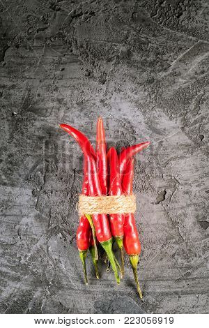 Red hot chilli pepper paprika on stone table Ingredient for Mexican cooking Trendy toned image in minimal rustic style Flat lay top view