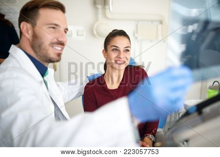 Nice girl in dental clinic with male dentist