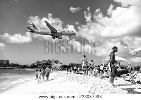 St Maarten, Netherlands - February 13, 2016: Beach Observe Low Flying Airplanes Landing Near Maho Be