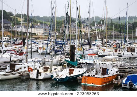 TREGUIER, FRANCE - JULY 2, 2010: boats in port of Treguier town on Jaudy river . Treguier is port town in the Cotes-d'Armor department in Brittany.