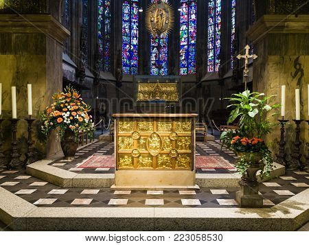 AACHEN, GERMANY - JUNE 27, 2010: view of golden altar (Pala d'Oro) and Charlemagne's shrine in glass chapel of Aachen Cathedral. The Dom was constructed by emperor Charlemagne from 796