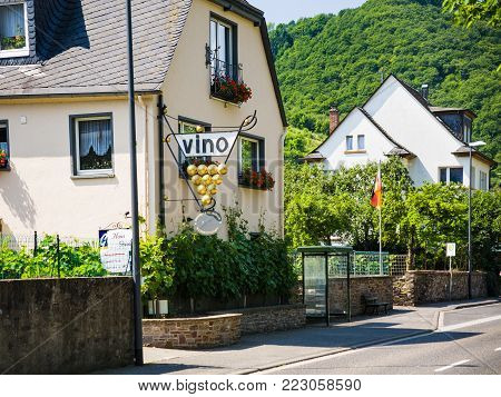 ZELL MOSEL, GERMANY - JUNE 28, 2010: vine restaurants and guest houses along Moselle wine route in Mosel river valley in Cochem - Zell region in sunny summer day