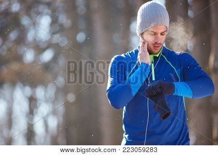 Male controls pulse on condition training outdoor