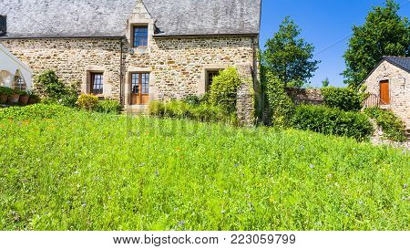 PLOEZAL, FRANCE - JULY 3, 2010: green lawn on courtyard of medieval castle Chateau de la Roche-Jagu in Cotes-d'Armor department of Brittany in sunny summer day. The castle was built in 1418.