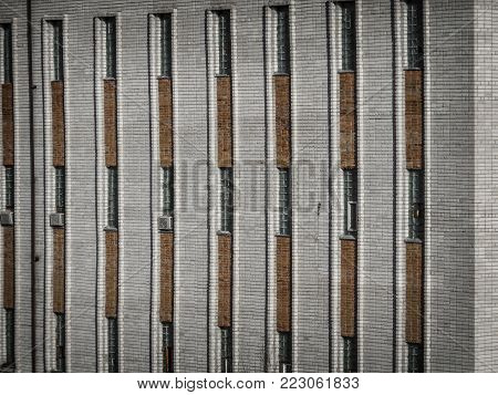 Fragment of an old industrial building. Old building fragment. Architectural background