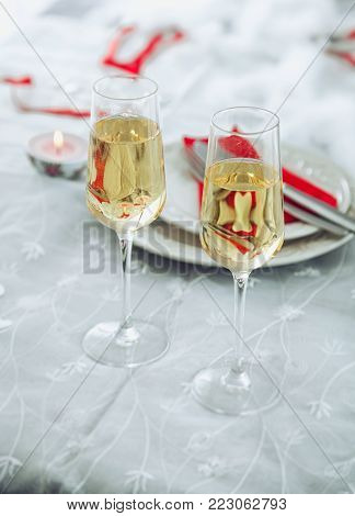Valentines day table. Champagne glasses toast. Valentine's day dinner.St. Valentine table setting