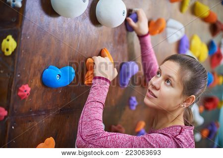portrait of a sporty woman in boulder climbing hall
